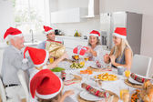 Family swapping christmas presents — Stock Photo