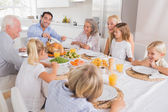 Father proposing a slice of turkey — Stock Photo