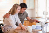 Young couple looking laptop screen — Stock Photo