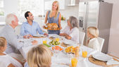 Mother serving the turkey — Stock Photo