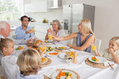 Smiling family raising their glasses together — Stock Photo
