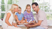 Calm family reading a story together — Stock Photo