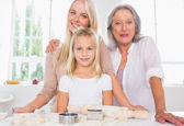 Mothers and daughters cooking together — Stock Photo