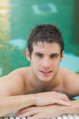 Handsome man in the pool — Stock Photo