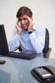 Portrait of business man with severe headache — Stock Photo