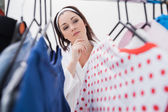 Woman selecting clothing — Stock Photo