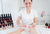 Manicure treatment at nail spa — Stock Photo