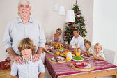 Grandfather and grandson standing beside the dinner table — Stock Photo