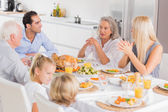 Family enjoying the thanksgiving dinner — Stock Photo