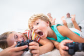 Brother and sister playing video games and having fun — Stock Photo