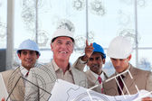 Smiling architects seeing plan come to life — Stock Photo