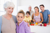 Grandmother and granddaughter standing beside counter — Stock Photo