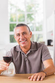 Man holding glass of red wine — Stock Photo