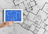 Digital tablet displaying blueprint — Stock Photo