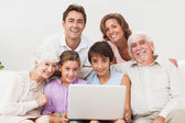Multi-generation family on couch — Stock Photo