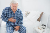 Aged man suffering with belly pain — Stock Photo