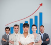 Business team smiling with a graph illustration — Stock Photo