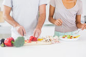 Couple making a salad — Stock Photo