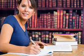 Smiling woman and writing — Stock Photo