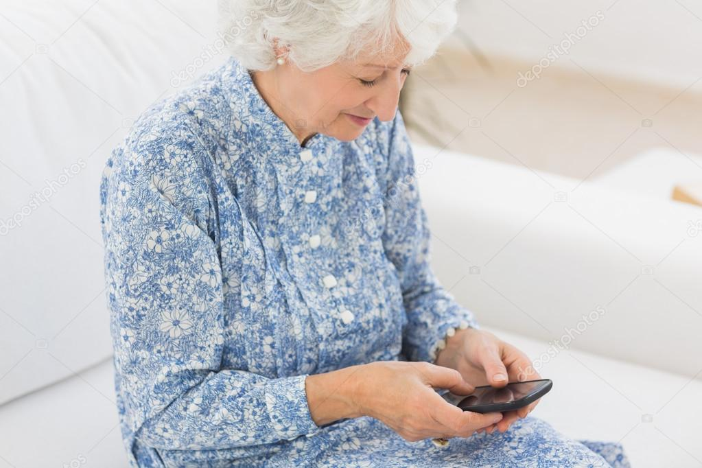 Elderly Using Facebook Elderly Cheerful Woman Using a