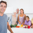 Father standing by kitchen counter — Stock Photo #24110061