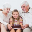Little girl with grandparents celebrating birthday — Stock Photo