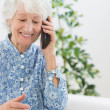 Elderly happy womcalling someone — Stock Photo #24110247
