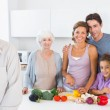 Grandfather standing by kitchen counter — Stock Photo #24110267