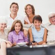Extended family watching tv — Stock Photo