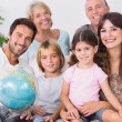Smiling family with globe — Stock Photo #24110655