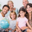 Smiling family with globe — Stock Photo