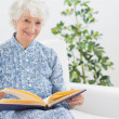 Elderly womwatching pictures — Stock Photo #24110939