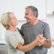 Happy couple dancing together — Stock Photo