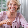 Happy woman playing chess — Stock Photo