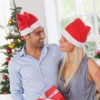 Smiling couple at christmas — Stock Photo