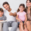 Happy family watching television together - Foto Stock