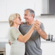 Smiling couple dancing together — Stock Photo #24111551