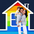 Embracing family standing with a house illustration — Stockfoto