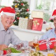 Family swapping christmas presents - Stock Photo
