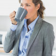 Stock Photo: Womhaving coffee before work