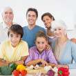 Multi generation family smiling in kitchen — Stock Photo