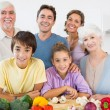 All the family smiling in kitchen — Stock Photo
