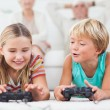Siblings playing video games — Stock Photo #24112557