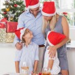 Happy family at christmas - Stock Photo