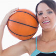 Portrait of happy woman holding basketball on shoulder — Stock Photo
