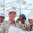Royalty-Free Stock Photo: Architects looking at plan come to life