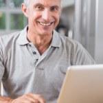 Man using his laptop — Stock Photo #24113001