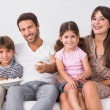 Smiling family watching the television — Stock Photo