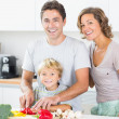 Happy family preparing vegetables — Stock Photo #24113261