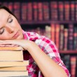 Woman sleeping on books — Stock Photo